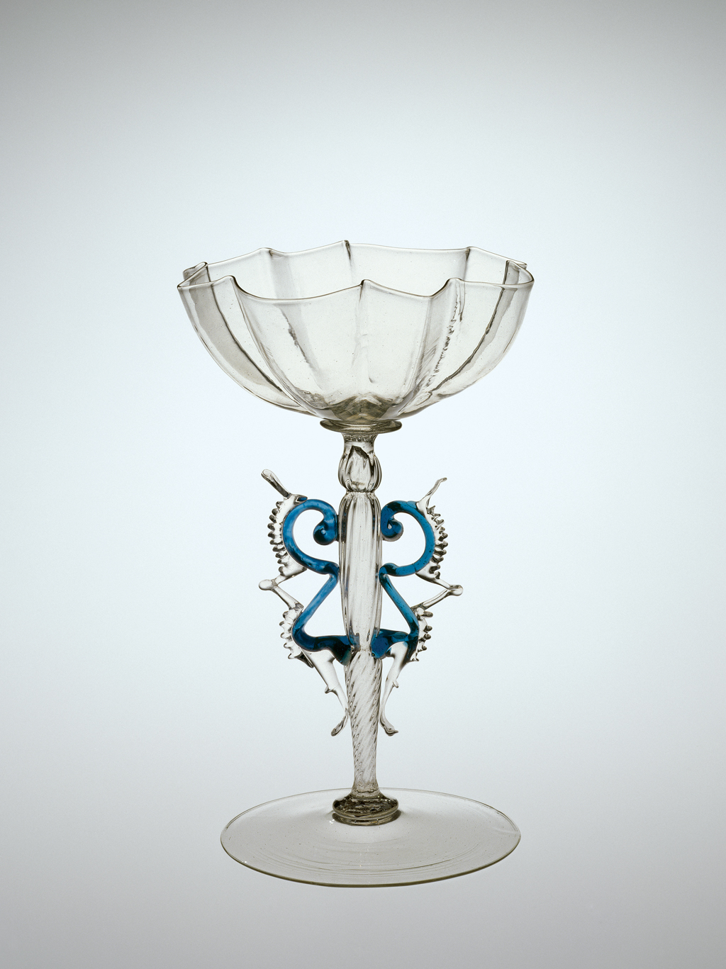 FIG. 47. Winged goblet, blown, applied, tooled. Probably Venice, 17th century. H. 17.3 cm, W. 11.1 cm, D. (foot) 11 cm. The Corning Museum of Glass (2000.3.13).