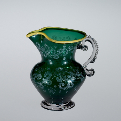 FIG. 46. Jug, blown, engraved, tooled, applied. Venice, 1675–1725. H. 10.1 cm, D. 7.8 cm. The Corning Museum of Glass (50.3.8).