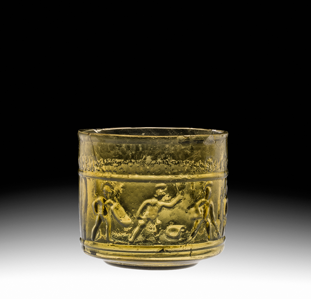 FIG. 7. Cup with gladiators. Roman Empire, first century A.D. H. 7.1 cm, D. (rim) 7.5 cm. The Corning Museum of Glass (54.1.84).