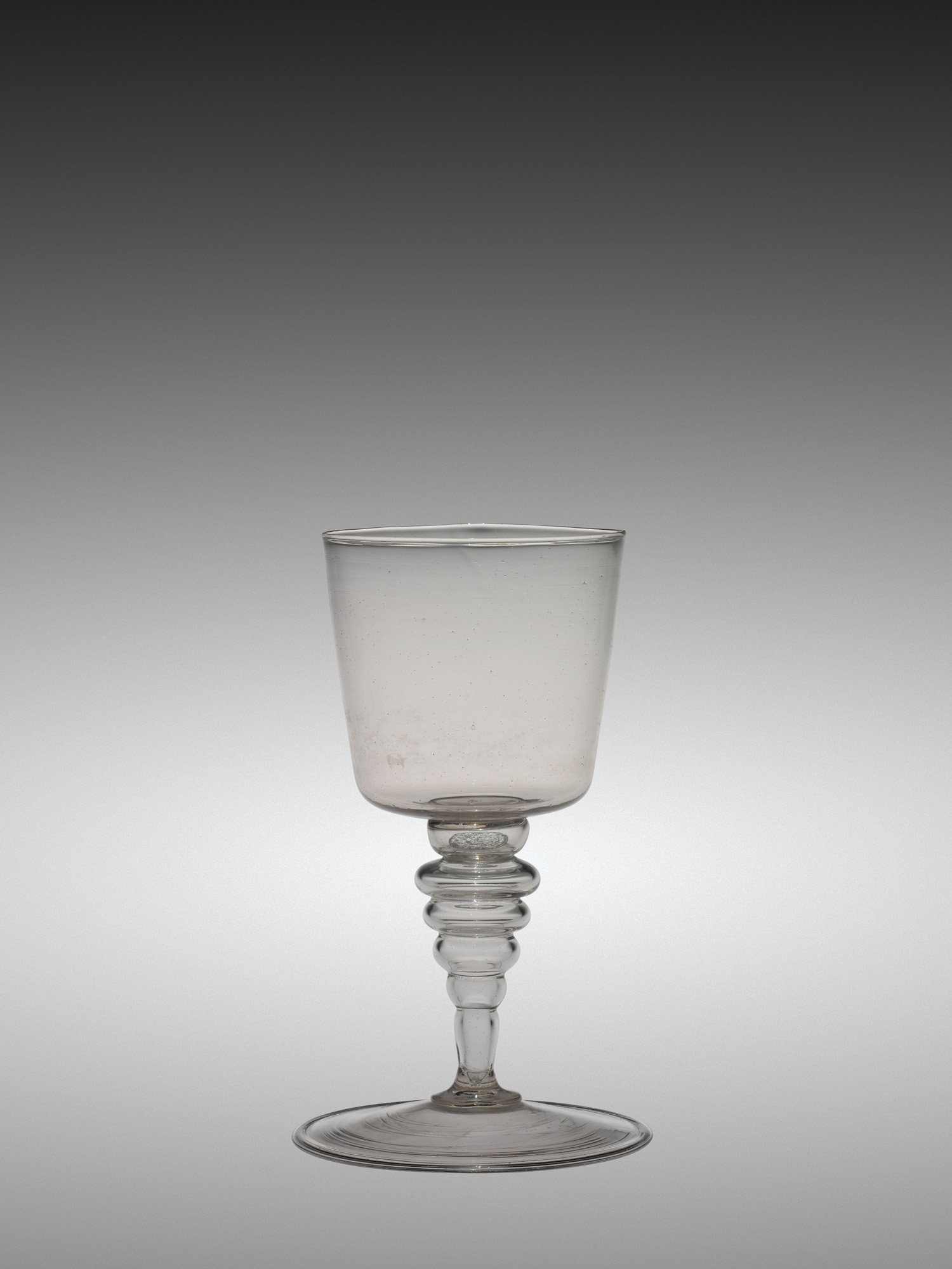 Wineglass with Coin in Stem