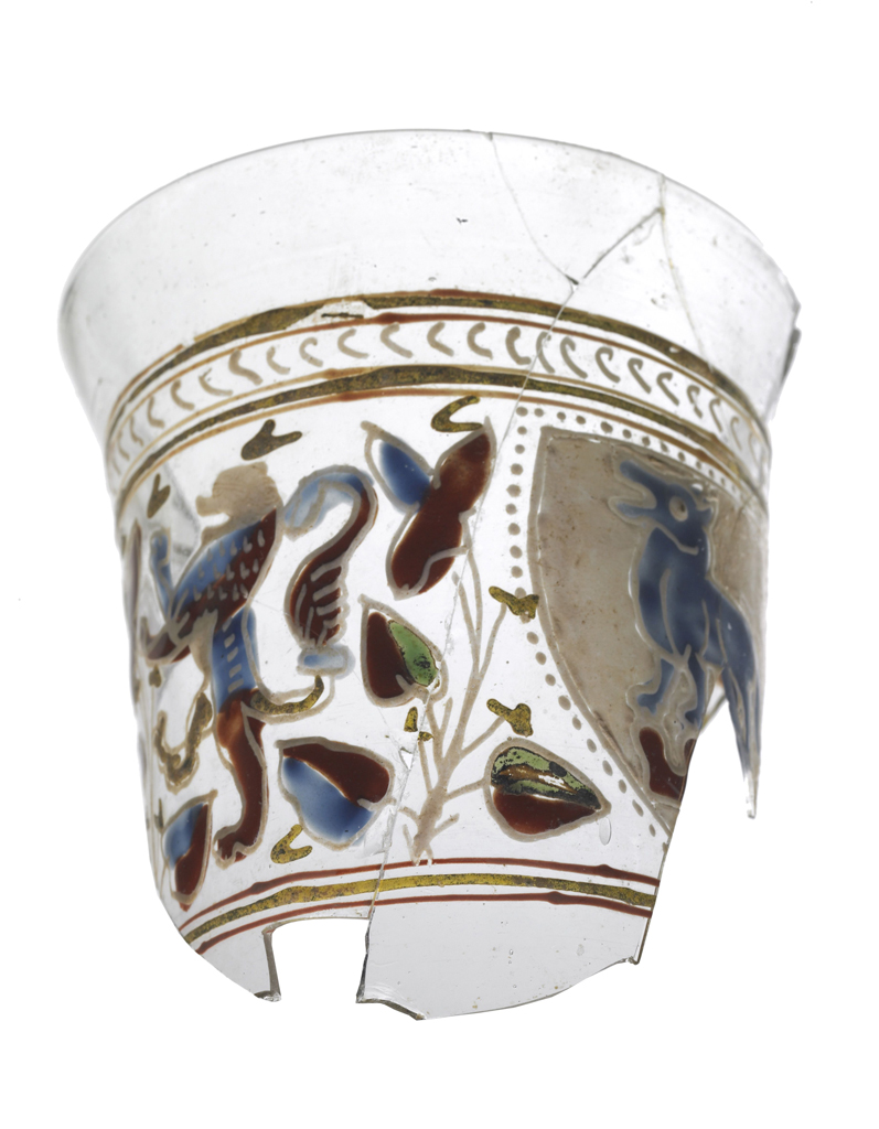 FIG. 15. Fragment of heraldic beaker, found in goldsmith's quarter of London at 7–10 Foster Lane. Probably Venice, about 1290–1325. H. 9.5 cm, D. 8.8 cm. Museum of London (OST82[190]<128>). Photo: © Museum of London.